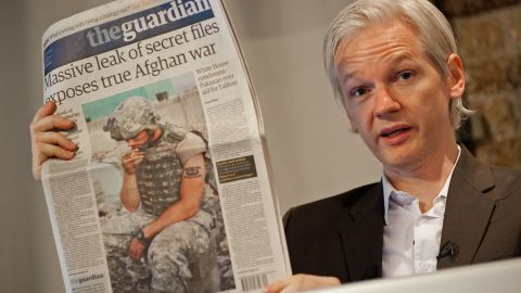Julian Assange holds up a copy of The Guardian newspaper in London, England on July 26, 2010.