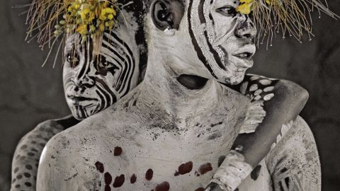 An estimated 200,000 tribal people live in the Omo Valley in Ethiopia. The Karo are small in number with around 3,000 living on the Omo River's eastern banks. Before a ceremony, they paint their bodies and faces with white chalk.