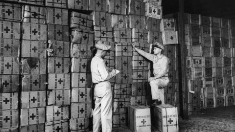 American Red Cross workers check packages for troops fighting in Leyte, Philippines, on November 20,1944. The International Committee of the Red Cross won the Nobel Peace Prize in 1944.