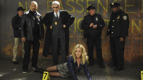 """The gang at """"30 Rock"""" receives a visit from Ice-T, left, and Belzer in character when Jenna Maroney (played by Jane Krakowski) lands a role on """"SVU"""" as a corpse."""