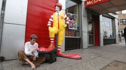 One of Banksy's pieces is this fiberglass sculpture of Ronald McDonald having his shoes shined in front of a Bronx McDonald's.