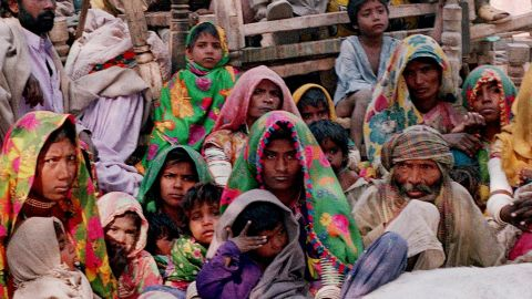 A group of Pakistani bonded laborers including women and children sit with their belongings after their release in a village Kahpro, some 280 kilometers east of Karachi. The country, with large populations of displaced people and weak rule of law, has an estimated 2.2 million slaves.