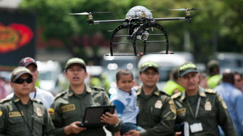 """<strong>Protect and serve: </strong>after the military, police forces were among the first to declare an interest in drones. In May, Colombian police revealed this surveillance quad-coptor -- designed to protect Latin American heads of state at the VII Pacific Allianz Summit -- and UAVs have been <a href=""""http://articles.washingtonpost.com/2011-03-23/world/35261451_1_drones-scaneagle-farc"""" target=""""_blank"""" target=""""_blank"""">used in counter-narcotics operations in the country since 2006</a>."""