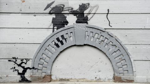 Banksy work in the Williamsburg neighborhood of Brooklyn, New York, was vandalized in broad daylight in October 2013.
