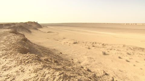 But surrounding sand dunes are beginning to engulf the set.
