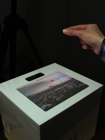 """First there were buttons, then there was the touchscreen. And now there is the hands-free touchscreen. Researchers from the <a href=""""http://big.cs.bris.ac.uk/"""" target=""""_blank"""" target=""""_blank"""">Bristol Interaction and Graphics Group</a> have developed <em>UltraHaptics</em>. Users can now get tactile feedback from a touchscreen mid-air.  """"Waves of ultrasound displace the air, creating a pressure difference. By causing many waves to arrive at the same place simultaneously, a noticeable pressure difference is created at that point. With this method, we are able to create multiple, concurrent points of haptic feedback in mid-air."""""""