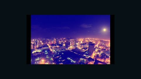 A cityscape of Eastern Nairobi at night, created by combining numerous photographs. Kenyan photographer Mutua Matheka shot it from a rooftop.