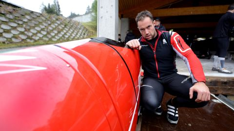 Italian bobsledder Simone Bertazzo inspects the sled he hopes will carry him and his teammates to gold at Sochi 2014. Its red livery is the hallmark of its designers, the legendary automotive manufacturer Ferrari.
