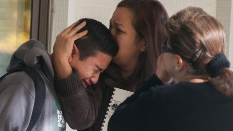 A Sparks Middle School student is comforted after being released from Agnes Risley Elementary School, where some students were evacuated to after the shooting.