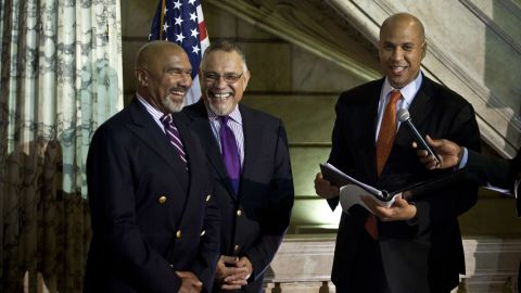 On October 21, 2013, Cory Booker, right, officiates a wedding ceremony for Joseph Panessidi, center, and Orville Bell at the Newark, New Jersey, City Hall. The New Jersey Supreme Court denied the state's request to prevent same-sex marriages temporarily, clearing the way for same-sex couples to marry.