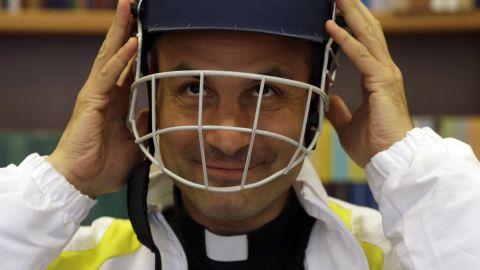 Monsignor Sanchez de Toca y Alameda wears a helmet during the presentation of the Vatican cricket club on October 22.