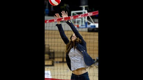 Here, Catherine plays volleyball during a trip to the SportsAid Athlete Workshop on October 18. Photographers and onlookers noticed her flat tummy, just a few months out from giving birth to Prince George.