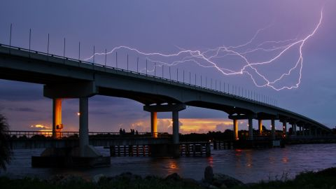 """The lightning's quick movement and the way it contrasted with the colors of the sunset caught Billy Ocker's eye in <a href=""""http://ireport.cnn.com/docs/DOC-1008938"""">his photo</a> from Florida's Sebastian Inlet on July 21."""