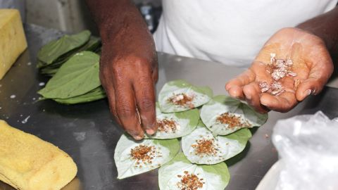 """Areca """"nuts"""" are added to the parcel, though they're not really nuts. They're seeds that come from the areca palm, which is grown throughout Asia."""