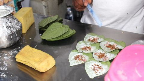 More lime is flicked onto the leaves before they're ready for wrapping.