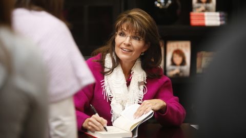 """Palin signs copies of her second book, """"American by Heart,"""" in Andover, Kansas, in November 2010."""