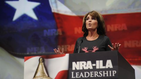 """Wearing a shirt that reads """"Women hunt,"""" Palin blasts Obama and gun control advocates for """"exploiting"""" recent mass shootings as she speaks to the National Rifle Association convention in Houston in May 2013."""