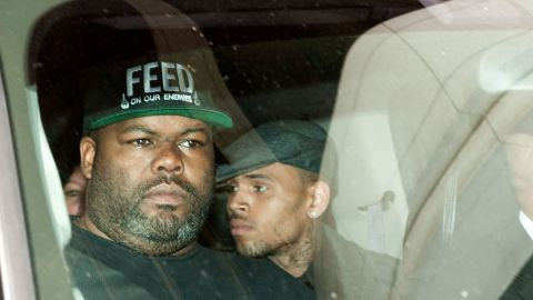 Brown, center, leaves criminal court in Los Angeles on November 1, 2012.