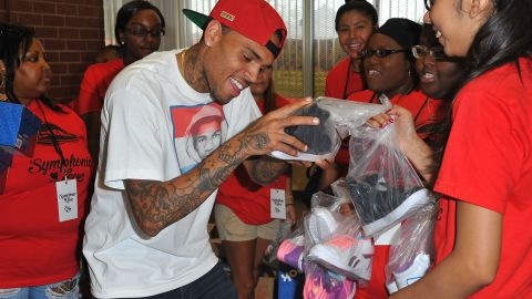 Brown greets fans in South Central Los Angeles on July 20.