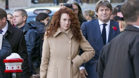 Former News International chief executive Rebekah Brooks arrives at the Old Bailey with her husband Charlie Brooks to hear the opening of the trial of conspiracy to hack phones at the Old Bailey on October 28, 2013 in London, England.