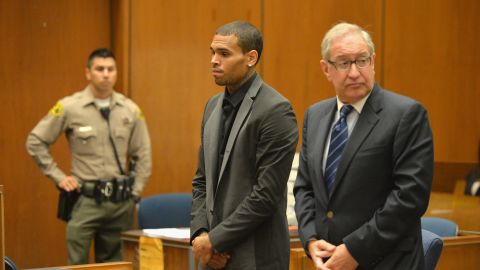 """<strong>July 2013:</strong> <a href=""""http://www.cnn.com/2013/08/15/showbiz/chris-brown-court/index.html"""">Brown's probation was revoked July 15</a> after he was accused of hit-and-run driving and driving without a license. A woman told investigators Brown """"went ballistic"""" after a traffic accident and screamed at her. The charges were dropped after Brown reached a """"civil compromise"""" with his accuser a month later. Here, he appears in court with his attorney, Mark Geragos."""
