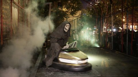 """Banksy's art exhibit """"Grim Reaper Bumper Car"""" sits on New York's Lower East Side in October 2013. The famously anonymous artist, whose paintings regularly go for six figures at auction houses around the world, said he was on a """"residency on the streets of New York."""""""