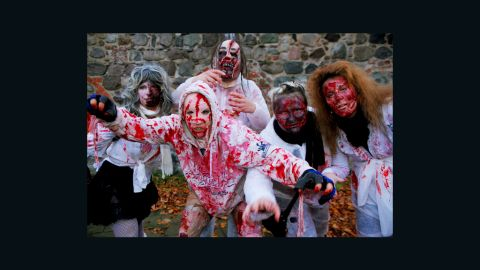 People dress up as zombies as part of the annual Zombie Walk in Berlin, Germany, on October 26, 2013. This walk traditionally occurs the last weekend before Halloween.