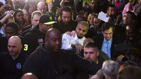 """<strong>October 2013:</strong> <a href=""""http://www.cnn.com/2013/10/28/showbiz/chris-brown-assault-charge/index.html"""">Brown and a bodyguard were accused of assaulting a man</a> on a Washington sidewalk on October 27. The man told police he tried to jump into a photo that Brown was posing for with a female fan when the singer said, """"I'm not down with that gay s--t"""" and """"I feel like boxing.""""  Isaac Adams Parker said Brown punched him in the face, the police report said. Brown was released from jail the next day."""