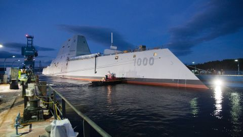 """The USS Zumwalt, the U.S. Navy's newest warship, floats out of dry dock Monday, October 28, in Bath, Maine. The first of the new <a href=""""http://security.blogs.cnn.com/2013/10/29/bigger-faster-deadlier-navy-launches-new-stealth-destroyer/"""">DDG-1000 class of destroyers</a>, it will be the Navy's largest stealthy ship when it begins missions."""