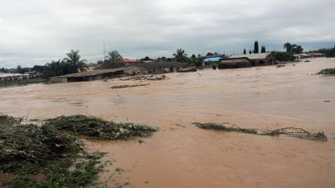 Floodwaters course through Odo Ona in Nigeria's Oyo State in 2011. At least 102 people were killed when a dam burst during torrential rain.