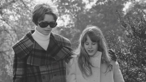 In this photo from the movie, Chris MacNeil, played by actress Ellen Burstyn, walks with her daughter Regan, played by Linda Blair, before Regan began exhibiting strange behavior.