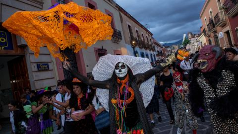 """Revelers dance through the streets in traditional costumes in Oaxaca on Wednesday, October 30. """"The first day of Dia de los Muertos is dedicated to honoring the lives of children who have passed away and adults are celebrated the next day,"""" says Cano-Murillo."""