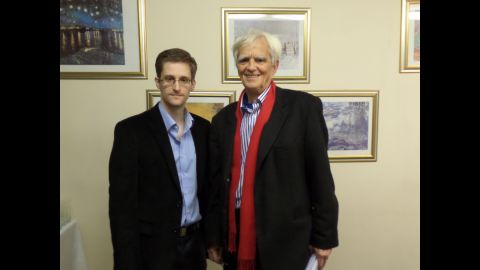 """National Security Agency leaker Edward Snowden poses with German Green party parliamentarian Hans-Christian Stroebele in Moscow on October 31. Stroebele returned from the meeting with a letter from Snowden to German authorities, which was distributed to the media. In it, Snowden said he is confident that with international support, the United States would abandon its efforts to """"treat dissent as defection"""" and """"criminalize political speech with felony charges."""""""
