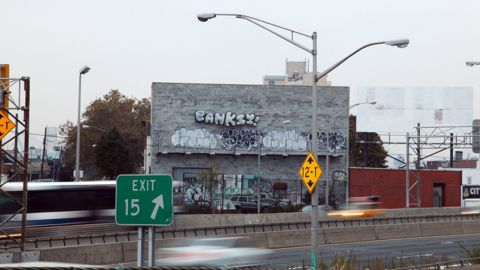 """A set of balloons that reads """"BANKSY!"""" is seen off the Long Island Expressway in Queens, New York, in October 2013. Banksy artwork appeared all over New York that month."""