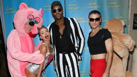 """Kelly Ripa, second from left, channeled a really good Miley Cyrus here with, from left, Art Moore, Michael Strahan and Michael Gelman at the """"LIVE With Kelly and Michael: Best Halloween Show Ever in New York."""