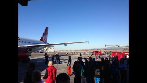 """The gunfire reports led to a """"ground stop"""" for arriving planes, said police and the Federal Aviation Administration."""