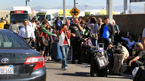 """""""People were running and people (were) getting knocked down. There was luggage everywhere,"""" traveler Alex Neumann said. """"Mayhem is the best I can describe it."""""""
