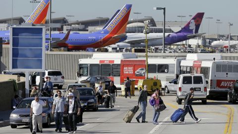 Passengers evacuate the airport after the incident, which airport officials said began about 9:30 a.m. The gunfire and the airport's announcement of the incident provoked chaos among travelers, passengers said.