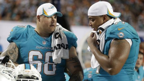 Incognito and Martin talk on the sideline during the second half of a preseason game August 24.