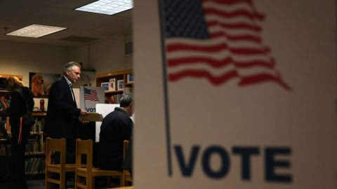 McAuliffe casts his vote. In the last nine elections, the political party controlling the White House lost the governor's race.