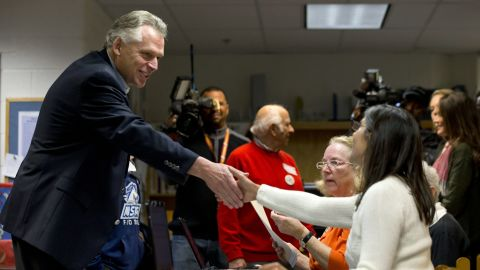 McAuliffe shakes hands with a poll worker as he arrives to vote at Spring Hill Elementary School in McLean, Virginia.