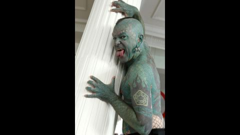 """Showman Erik Sprague, also known as """"The Lizardman"""" with his scales and forked tongue, poses for photographs during a 2012 interview in Madrid."""
