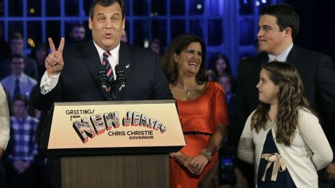Republican New Jersey Gov. Chris Christie signals second term as he stands with his wife, Mary Pat Christie, second right, and their children, Andrew, back right, Bridget, right, as they celebrate his election victory in Asbury Park, N.J., Tuesday, Nov. 5, 2013, after defeating Democratic challenger Barbara Buono. (AP Photo/Mel Evans)