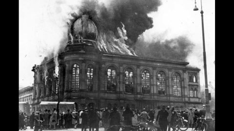 """The Boemestrasse Synagogue in Frankfurt, Germany, burns on November 10, 1938. The night of November 9 became known as """"Kristallnacht,"""" or the """"Night of Broken Glass,"""" after the Nazi regime staged attacks on Jewish-owned businesses, synagogues and homes throughout Germany."""