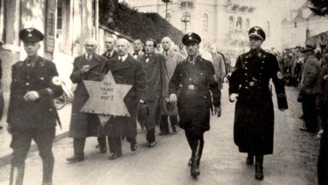 Nazi SS forces escort arrested Jewish men in Baden-Baden, Germany.