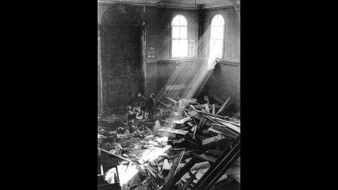 Children sift through debris in a ruined synagogue in Koenigsbach, Germany.