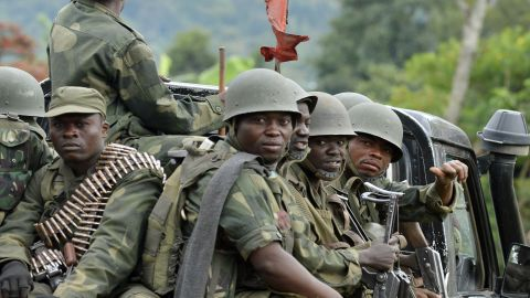 Military successes in the Democratic Republic of Congo have led the M23 militia group to announce its intention to disarm.<br />Pictured, army soldiers head towards the Mbuzi hilltop, near Rutshuru, on November 4, 2013, after the army recaptured the area from M23.