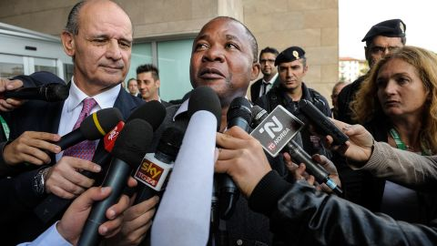 Patrick Lumumba, the Congolese bartender Knox originally accused of Kercher's murder, talks to the press outside the courthouse during a break form the appeal trial of Knox and Sollecito on September 30.