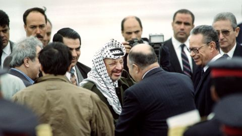 Arafat is greeted by Tunisian Defense Minister Abdelaziz Ben Dhia upon his arrival at the Tunis airport on April 10, 1992. Days earlier, Arafat survived a plane crash over the Libyan desert that killed the pilot and two others.
