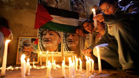 Palestinians hold a candlelight vigil for an ailing Arafat in Ramallah on November 10, 2004. A top aide said Arafat suffered a brain hemorrhage.